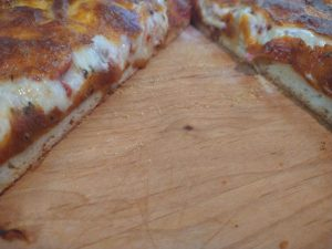 Artisan pizza cut and served 2